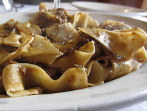 Pappardelle with boar ragu. Tuscan typical recipe of italian pasta Royalty Free Stock Photo
