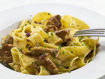 Pappardelle with chanterelles Royalty Free Stock Images