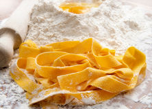 Pappardelle. Fresh pasta, pappardelle on the table Stock Image