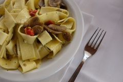 Pappardelle with mushrooms. On table Stock Photo