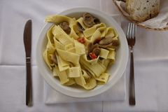 Pappardelle with mushrooms. On table Royalty Free Stock Photos