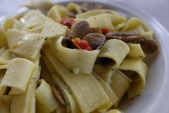 Pappardelle with mushrooms. On table Stock Images