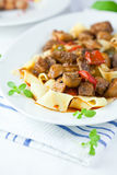 Pappardelle pasta with beef goulash Royalty Free Stock Image