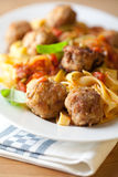 Pappardelle pasta with meatballs. Pappardelle paste with tomato sauce and meatballs Royalty Free Stock Photo