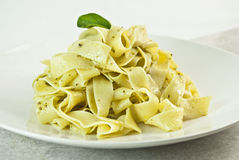 Pappardelle pasta with pesto Stock Photography