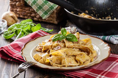 Pappardelle pasta with prosciutto and cheese sauce on a plate Stock Image