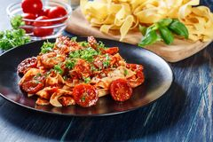 Pappardelle pasta with shrimp, tomatoes and herbs. Italian cuisine Stock Photos