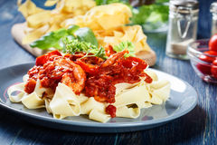 Pappardelle pasta with shrimp, tomatoes and herbs Stock Images