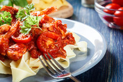 Pappardelle pasta with shrimp, tomatoes and herbs Stock Image