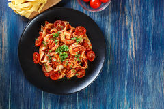 Pappardelle pasta with shrimp, tomatoes and herbs Royalty Free Stock Photography