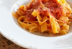 Pappardelle pasta with tomato sauce Stock Photos