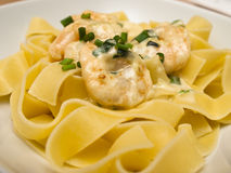 Pappardelle with shrimp Stock Images