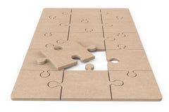 Pappe-Zigsaw-Puzzlespiel lizenzfreie stockbilder