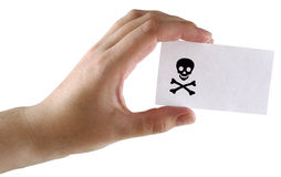Papper card on the hand. Paper card with the image black jolly Roger in a hand on a white background royalty free stock photo