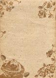 Papper i beige färgsignal med prydnaden i form av rosor Arkivbilder