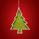 Papper som klipps för att bilda julgranen Arkivbilder