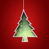 Papper som klipps för att bilda julgranen Arkivfoto