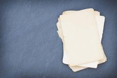 Pappers- ark på svart tavla Fotografering för Bildbyråer