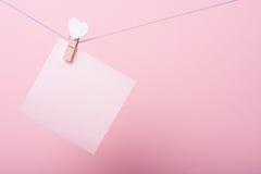 Pappers- ark på tråden Royaltyfria Foton