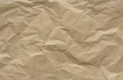 Pappers- bakgrund för rynkig brunt arkivfoton