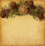 Pappers- bakgrund med julgränsen Arkivfoton