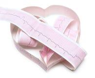 Pappers- ECG-graf i form av hjärta Arkivbild
