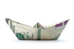 Pappers- fartyg för dollar arkivbild