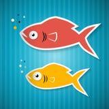 Pappers- fisk på blå papp Fotografering för Bildbyråer