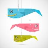 Pappers- fiskhängning på rader Arkivfoto
