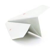 Pappers- flygplan på vit Royaltyfria Foton