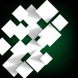 Pappers- fyrkantigt baner på grön bakgrund Arkivfoto