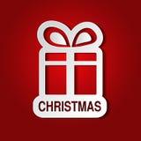 Pappers- gåva för vit jul med pilbågen - bandet, röd bakgrund - EPS 10 Royaltyfri Foto