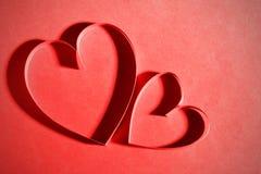 Pappers- hjärta två Arkivfoto