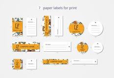 Pappers- klädetiketter för vektor för tryck med modellliljor Royaltyfria Bilder