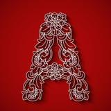 Pappers- klipp, vit bokstav A Röd bakgrund Blom- prydnad, traditionell stil för balinese Royaltyfri Foto