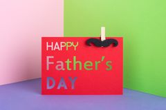 Pappers- kort för idérik lycklig dag för fader` s med mustaschen Fotografering för Bildbyråer