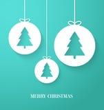 Pappers- kort för jul med den hängande leksaken Arkivfoto