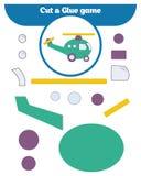 Pappers- lek för utvecklingen av förskole- barn Snittdelar av bilden och limmet på papperet Arkivbilder