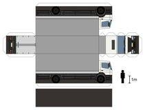 Pappers- modell av en lastbil Arkivfoto