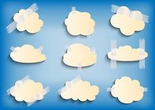 Pappers- moln med tejpsamlingen Arkivbild