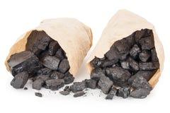 Pappers- påsar med kol arkivfoton
