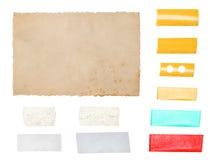Pappers- papp med bandremsor som isoleras på vit bakgrund Royaltyfri Fotografi