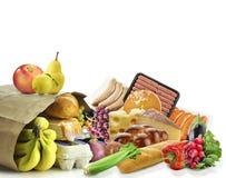 Pappers- påse med mat Arkivfoto