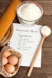 Pappers- recept och brödingredienser Arkivfoto