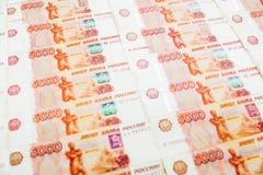 Pappers- sedel för ryss 5000 rubel bakgrund Fotografering för Bildbyråer