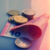 Pappers- sedlar av tio euro och mynt Royaltyfri Fotografi