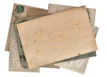 Pappers- sida och vykort som isoleras på vit arkivbild