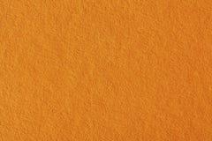 Pappers- textur, orange kraft arkbakgrund Högt upplösningsfoto royaltyfri fotografi