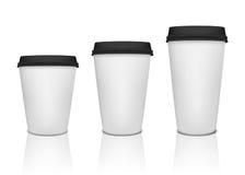 Pappers- uppsättning för kaffekopp Arkivfoto