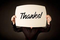 Pappers- uttryckande tacksamhet för affärsmaninnehav royaltyfri foto